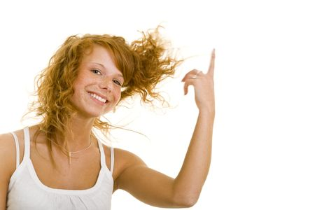 Young redhaired woman lets her hair fly Stock Photo - 5140371