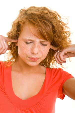 Young redhaired woman closing her ears photo