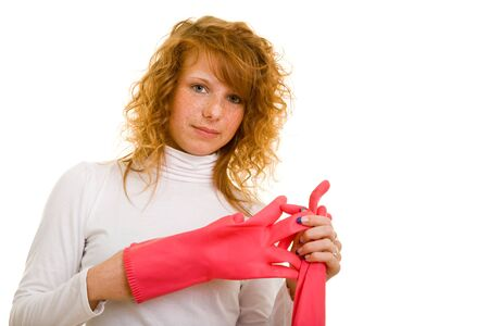 stereotypical housewife: Young woman is taking off her work gloves
