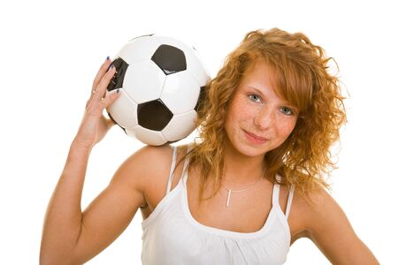 Young redhaired woman with soccer ball photo