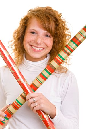 Young redhaired woman holding roles of wrapping paper photo