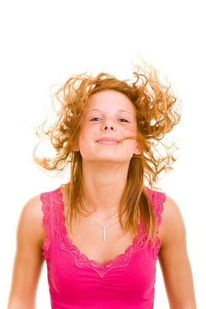 Young redhaired woman lets her curly hair fly Stock Photo - 5159382