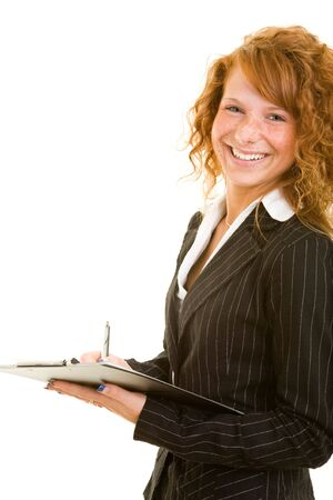 Young redhaired woman holding a clipboard and smiling photo