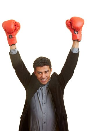 Business man holding his hands up with red boxing gloves Stock Photo - 5261929