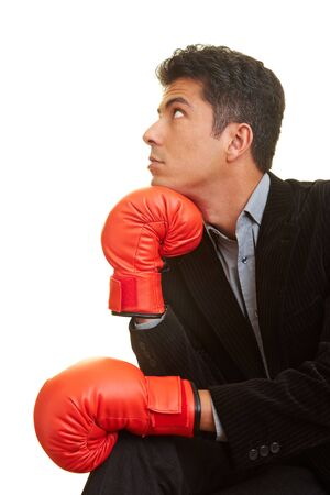 Business man with red boxing gloves in a thinker's pose Stock Photo - 5261963