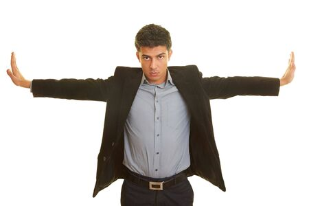 arms wide: Business man stretching his arms to the side
