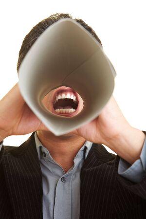 Businessman screaming through speaking tube photo