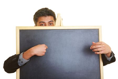 Man hiding behind a blackboard Stock Photo - 5261912