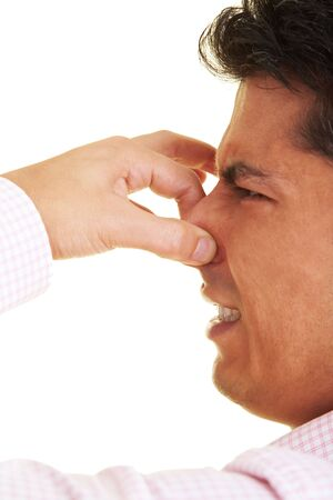 fetid: Man holding his nose closed