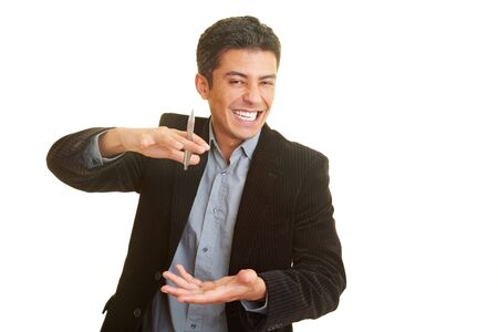 gesticulating: Businessman laughing and gesticulating while holding a speech