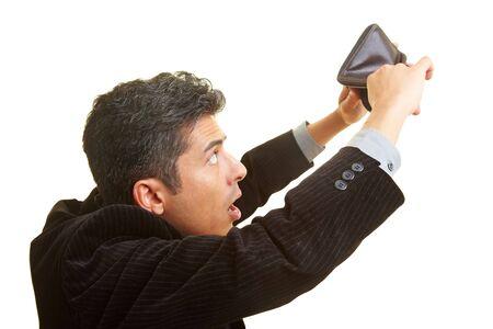 empty wallet: Businessman looking in his empty wallet