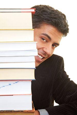 industriousness: Businessman peeking behind books