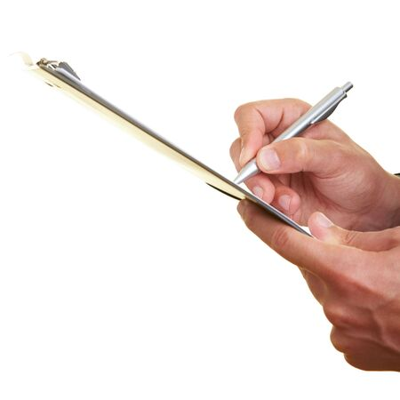 Hands holding a clipboard and writing photo