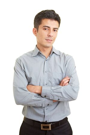 Businessman waiting with arms crossed photo