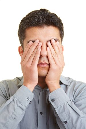 Man covering his eyes with his hands Stock Photo - 5265511