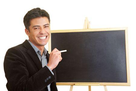 Happy man in front of a blackboard photo