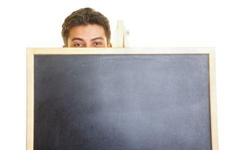 inhibition: Man hiding behind a blackboard