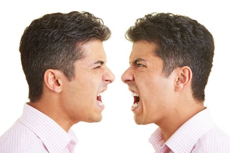 roar: Twins shouting at each other Stock Photo