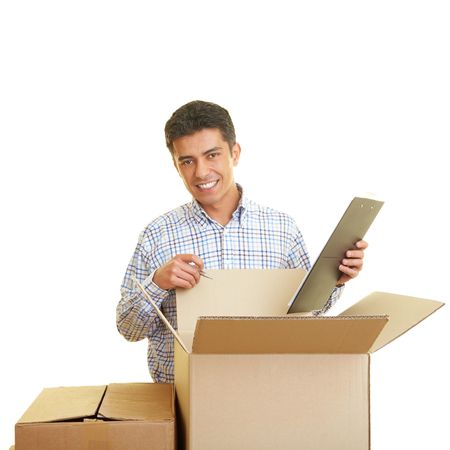 examiner: Man with clipboard counting cardboard boxes Stock Photo