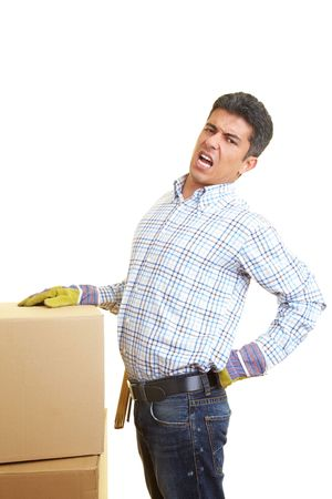 lean back: Man with cardboard boxes has pain in his back