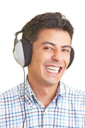 Happy man listening to music with headphones Stock Photo - 5265500