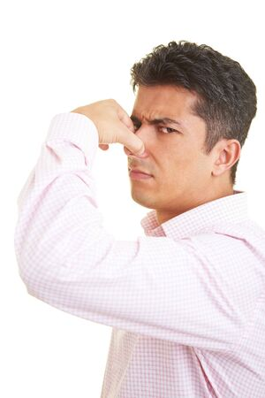 olfaction: Man holding his nose closed