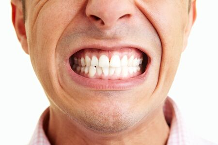 Man showing his teeth to the camera Stock Photo - 5265543