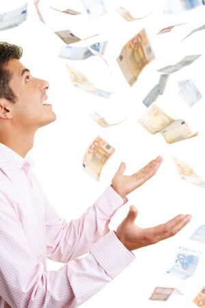 wasting away: Man holding up his hands for money falling from the sky