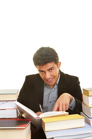 industriousness: Businessman learning with many books
