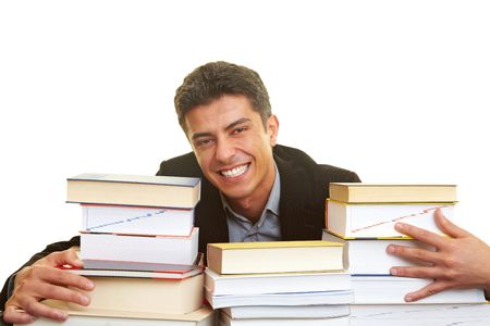 industriousness: Happy businessman with many books