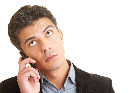 Businessman thinking while making a call on the mobile phone Stock Photo - 5285600