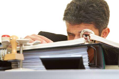 clandestine: Businessman looking through files Stock Photo