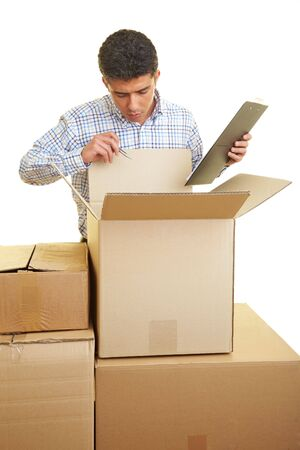 examiner: Man with clipboard counting the content of cardboard boxes Stock Photo