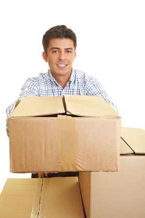 Man behind cardboard boxes holding a package Stock Photo - 5285650
