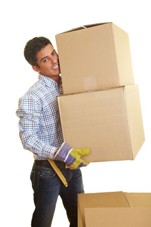 Happy man carrying two boxes photo