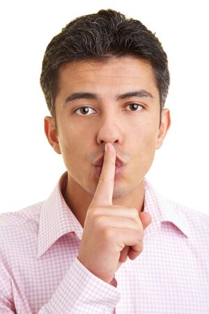 shush: Man putting his index finger on his lips Stock Photo