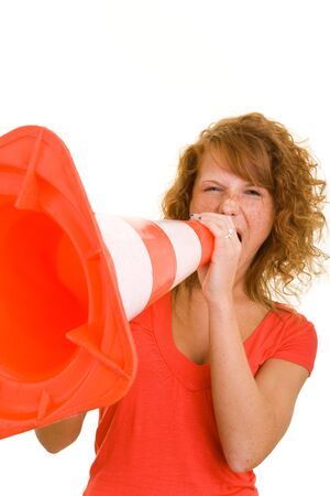 Young redhaired woman screaming in a traffic cone Stock Photo - 5288774