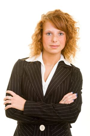 Young redheaded woman in a business suit Stock Photo - 5288757