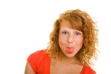 Young redhaired woman showing her tongue Stock Photo - 5288766