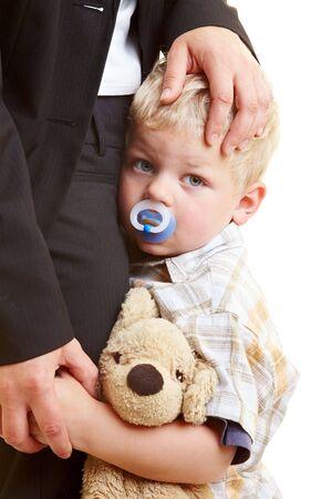 caress: Sad infant hugging his mother