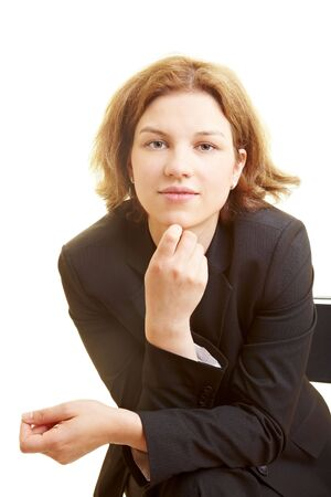 leaning forward: Business woman in a chair leaning forward