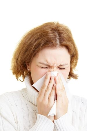 Woman cleaning her nose with a tissue Stock Photo - 5296308