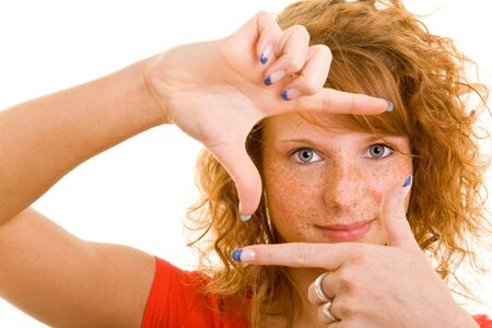 raised viewpoint: Young redhaired holding her hands as a frame Stock Photo
