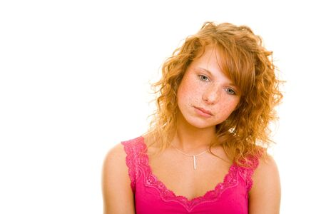 Young redhaired woman looking sad Stock Photo - 5313844