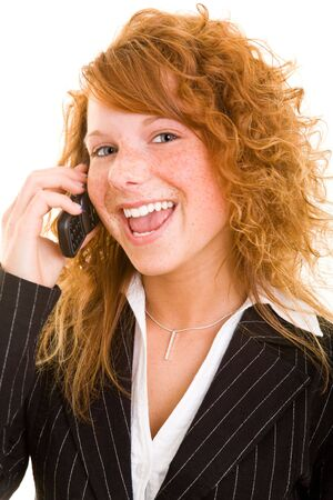 20 25: Young redhaired woman listening to her mobile phone Stock Photo