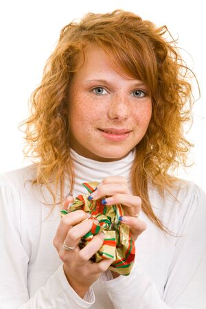 20 25: Young redhaired woman crumpling wrapping paper Stock Photo