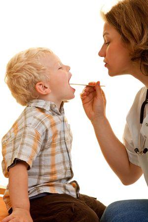 Pediatrist screening a young boy photo