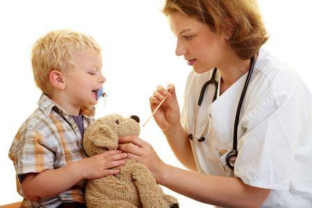 Boy checks his stuffed animal at the pediatrist photo