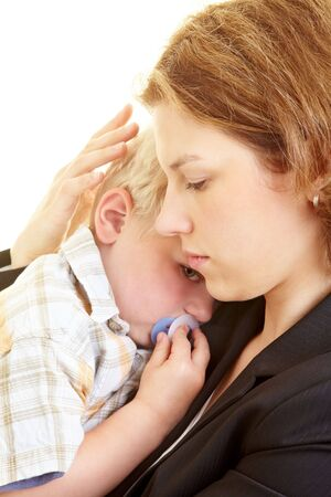 infants: Mother comforts her young son