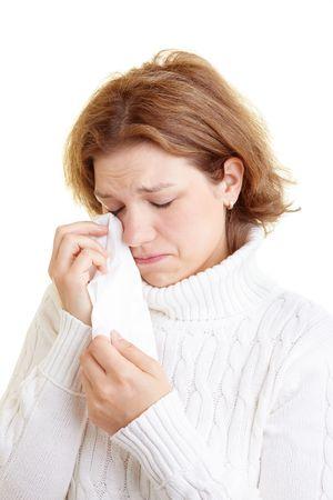 saddened: Sad woman drying her tears with a handkerchief